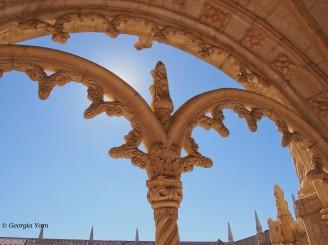 Sun behind arches