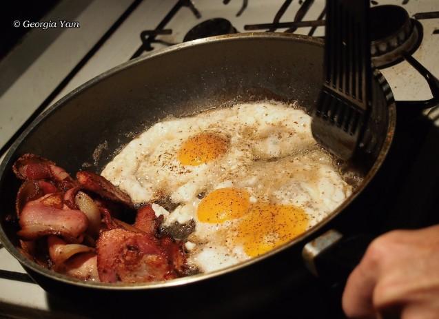 cooking bacon & eggs