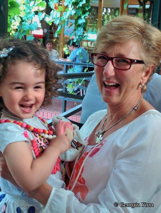 grandma & granddaughter laughing