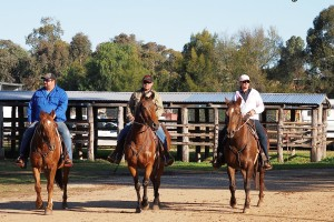 three horseriders