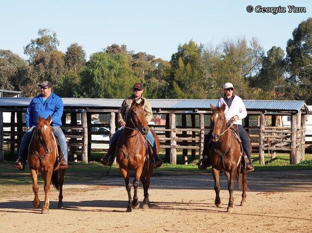 three horseriders